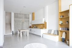 Minimalist Apartment Interior Design with White and Mustard Color Scheme