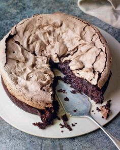 Double Baked Chocolate Meringue Brownie, from Chocolat by Eric Lanlard, published by Mitchell Beazley. After making this, I am convinced that all brownies need a meringue layer. Used 250 g sugar in the brownie and no vanilla extract in het meringue, came