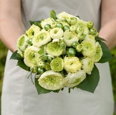 A Beautiful & Unique Wedding Bouquet Featuring: Green Ranunculus, Green Glass Ornaments & Greenery/Foliage Christmas Wedding Bouquets, Wedding Flowers, Ranunculus Wedding Bouquet, Green Wedding Decorations, Ornamental Cabbage, Bunch Of Flowers, Wedding Ideas, Wedding Fun, Wedding Things