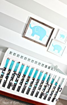 Picture frames... Vinyl elephants on wrapping paper in a frame... Genius!