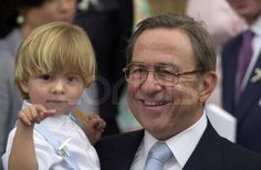 Prince Constantine-Alexios in the arms of his happy grandfather, King Constantine II. at the christening of his little brother, Prince Achileas-Andreas.