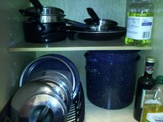 Kitchen Organization for Cheap! Using a dish drainer from the dollar store to keep lids organized and accessible.