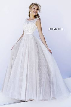 Sherri Hill 11230: All-over point d'esprit and lace is combined with an embroidered fitted bodice giving this classic ball gown a fresh look. #prom