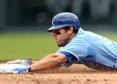Mike Moustakas #42 of the Kansas City Royals slides into second during the game against the Cleveland Indians on Jackie Robinson Day on April 15, 2012 at Kauffman Stadium in Kansas City, Missouri. (Photo by Jamie Squire/Getty Images)