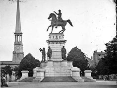 The Washington Monument on the grounds of the Virginia State Capitol Building in Richmond, VA.  It is interesting to note that this statue was designed with the intention of being the tomb for George Washington.