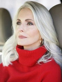 I love her platinum and grey hair against the red. Simply stunning.
