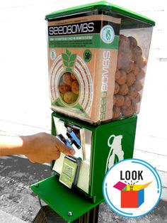 """Offering """"guerrilla gardening made easy,"""" the coin-operated Greenaid vending machine dispenses """"seed bombs"""" made from a mixture of clay, compost, and seeds that """"can be tossed anonymously into derelic Permaculture, Old Candy, Seed Bombs, Guerilla Marketing, Guerrilla Advertising, Marketing Innovation, Spiegel Online, Wildflower Seeds, Gumball Machine"""