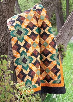 """Digital quilt pattern: Rudeneja is a fall-hued quilt of mainly half-square triangles. Modern Quilt Blocks, Modern Quilt Patterns, Quilt Patterns Free, Embroidery Patterns, Block Patterns, Sewing Patterns, Southwestern Quilts, Batik Quilts, Appliqué Quilts"