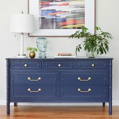 This faux bamboo Thomasville dresser is painted in a rich navy blue. The satin sheen reflects light and contrasts against the brass hardware