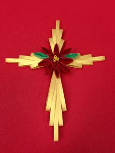 Quilled cross with poinsettia ornament