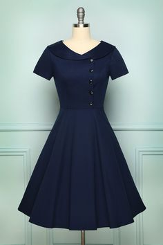 An A-line navy dress is for a semi-casual look. The top part is designed with lapel collar combined with V-neck cut. The buttons are asymmetrically round shaped to elevate feminine touch along with an embellishment of frills on the center. The vintage inspired dress is a combination of semi-formal and feminine style. Size Chart +Details Shipping SIZE BUST WAIST LENGTH XS 32.3 26.0 38.6 S 33.0 26.8 39.4 M 36.2 29.1 40.2 L 39.0 31.5 40.9 XL 41.3 33.9 41.7 2XL 43.7 36.2 42.5 3XL 45.3 37.8 43.3 Note Vintage Outfits, Vintage 1950s Dresses, Vestidos Vintage, Vintage Inspired Dresses, Vintage Clothing, 1940s Inspired Fashion, Retro Dress, Navy Dress Outfits, Fashion Dresses