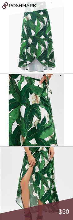 Palm leaf tropical print wrap skirt NWOT! This is a midi, asymmetrical, high-low wrap skirt.  Good quality, not see-thru. Highly blogged palm leaf print. Bought for vacation but never wore because I overpacked and needed to remove some items never worn & I know I have too many wraps and caftans to count for summer. No trades. Skirts Midi