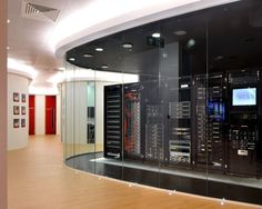 OK, perhaps this is slightly unrealistic for an SME, but it does show that you can make a server room look good and be neat. Rackspace's New UK Home of Fanatical Support Office Interior Design, Office Interiors, Data Center Design, Data Room, Uk Homes, Home Network, Home Automation, Decoration, Cool Stuff