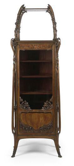 An Art Nouveau carved walnut and marquetry cabinet circa 1900
