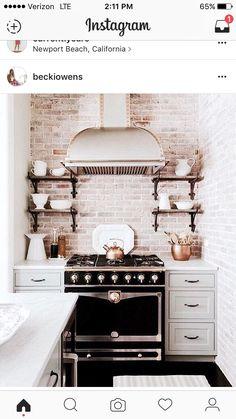 Whitewash brick kitchen