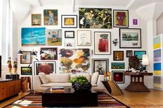 A New Loft by Stacy Weiss of Weisshouse- Gallery wall in living room on large wall by the door