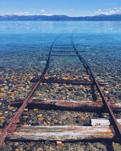 Tracks dissapear below the surface of Lake Tahoe, California Photo by @heathcopper Fascinating Pictures (@Fascinatingpics)   Twitter