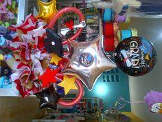 Areglo de mesa en globos metalico, vejigas pencil, globoestrella para centro de mesa de Graduacion