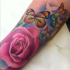 butterfly and flower tattoo. I love thecolor in this. Arm Tattoos, Rose Tattoos, Flower Tattoos, Sleeve Tattoos, Tatoos, Butterfly Tattoos, Cover Tattoo, I Tattoo, Wicked Tattoos