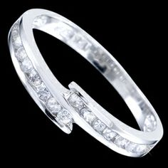 Silver ring, zirconia, ring Silver ring, zirconia, Ag 925/1000 - sterling silver. Very pleasing ring with the line of zircons connected in the middle. Pattern height at the widest part approx. 4.2mm, gradually narrows towards to the back up to approx. 2mm.
