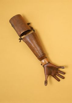 Piano player Roydon prosthetic arm, 1904. The wooden hand is designed to allow the wearer to span an octave on the piano.