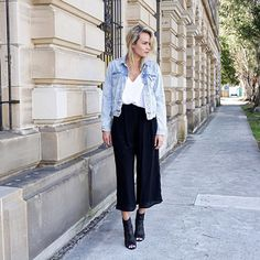 Australian blogger Brooke Testoni plays up our go-to outfit — white T-shirt, black pants, jean jacket — with some not-so-typical silhouettes. Instead of black skinny jeans, Brooke picked wide-leg cropped trousers, which look decidedly more sleek when paired with caged sandals.