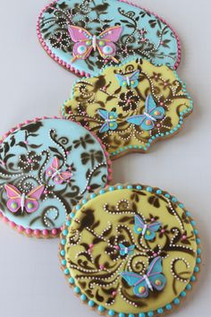 Butterfly cookies, stenciled two ways, by Julia M. Usher, www.juliausher.com