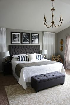All over grey. large b frames over bed. floor to ceiling curtains.