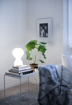 Gatto table lamp by Flos. Aristidia merino/cashmere plaid by Svenskt Tenn.