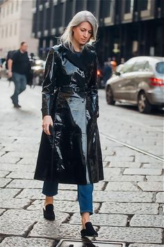 MILAN, ITALY - FEBRUARY 26  Sarah Harris in a black latex leather jacket  during 3054e3baf7