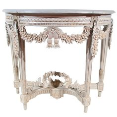 "French Louis XV revival style demi lune console. CIRCA: 1920's DIMENSIONS: 18"" h x 32"" w x 38"" d"