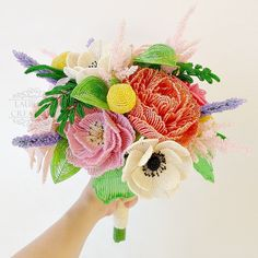 Turning my beaded flowers into wedding bouquets, boutonnieres, and eventually corsages and cake toppers as well, is a newer venture for me. :) This section of my Portfolio will be growing as I add...