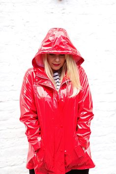 Be inspired by the people in the street! www.streetstylecity.blogspot.com shiny red rain slicker hood