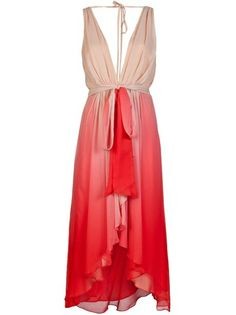 V-neck ombre dress in tulip pink from Haute Hippie. This layered silk sleeveless dress features a plunging v-neck and back, empire empire waistline, front ruffles, and high-low hem. Has matching waist tie belt.