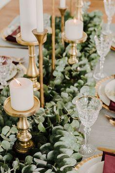 Gold candles, greenery. Wedding