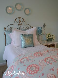Aqua blue is a great color to take a little girl's bedroom all the way through the teen years--it works with browns, pinks, and a variety of metal finishes.  Layering bedding and throw pillows creates a casual yet cozy look, and the aqua and white trellis lamp pulls it all together.  {Sponsored by HomeGoods}