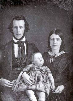You can tell it must have been difficult for the living families members. The pain in these parents' faces as they hold their dead child is obvious.