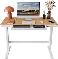 Amazon.com: FLEXISPOT Comhar Standing Desk with Drawers Electric Sit Stand up Desk with Storage 48 x 24 Inches Bamboo Texture Desktop & Height Adjustable White Frame (USB Charge Ports, Child Lock): Home & Kitchen Office Electrics, Bamboo Texture, Electric Standing Desk, Sit Stand Desk, Touch Lamp, Adjustable Height Desk, Desk Storage, Desk With Drawers, Home Office Desks