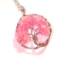 Did you know that cherry blossom trees die in just a couple of weeks? Well... this cherry blossom necklace won't. We are in love with the light pink petals! #treeoflife #jewelry #cherryblossom