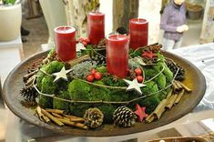 Moss wreath with red – nature - Christmas Decorations Nordic Christmas, Modern Christmas, Christmas Time, Christmas Wreaths, Advent Wreaths, Reindeer Christmas, Advent Candles, Christmas Candles, Outdoor Christmas Decorations