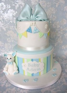 A christening cake for little Adam comprising a top layer of double chocolate and bottom of vanilla and raspberry