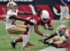 49ers vs. Cardinals:  23-20, Cardinals  -  November 13, 2016  -    Arizona Cardinals wide receiver Larry Fitzgerald (11) is tackled by San Francisco 49ers cornerback Tramaine Brock (26) during the first half of an NFL football game, Sunday, Nov. 13, 2016, in Glendale, Ariz.