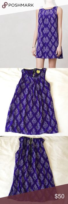 """Anthropologie Maeve Purple Petal Stamp Dress Purple printed """"Petal Stamp"""" Maeve dress from Anthropologie in loose swing fit. Silk with polyester lining, tie in back. 34.5"""" long. Has pockets! Size S, in excellent used condition except small cluster of stains on lining- not visible at all when worn, see photos. Bundle 2 or more items to save 20%! Anthropologie Dresses"""