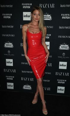 Red hot! Supermodel Martha Hunt, 28, ensured all eyes were on her thanks to a cherry red PVC dress with spaghetti straps