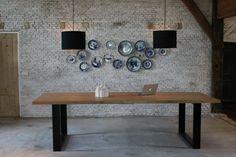 Eiken houten tafel met stalen onderstel Koak design