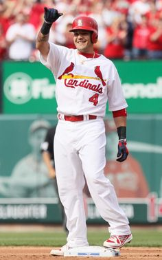 Cardinals Yadier Molina reacts after reaching on an error by Cincinnati center fielder Shin-soo Choo in first inning action during a game between the St. Louis Cardinals and the Cincinnati Reds on Monday, April 8, 2013, at Busch Stadium in St. Louis. Photo by Chris Lee, clee@post-dispatch.com