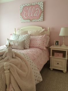 Sweet Ella's room. A magical Girly girl room with Ballerina, gold polka dot and plush bedding from @potterybarnkids. Walls painted in Sherwin Williams Lighthearted Pink. Custom art canvas from MemeHill.com