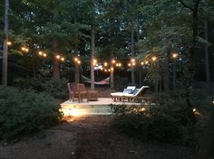 My new backyard floating deck with string lights.  Furniture from Overstock and Wayfair.  Pillows from Potterybarn.