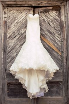 We love the contrast of this new, #stunning, #stylish #weddinggown offset by the harsh, #worn, #woodendoors. Gorgeous #composition for a gorgeous dress! ::Catie + Justin's chic modern wedding in Forsyth, Georgia:: #thedress #whitedress #fashion #mermaiddress #allure #dressbyallure #allurefashion @Stacy Bridals