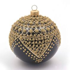 Striking deco bauble with gold drop detailing.